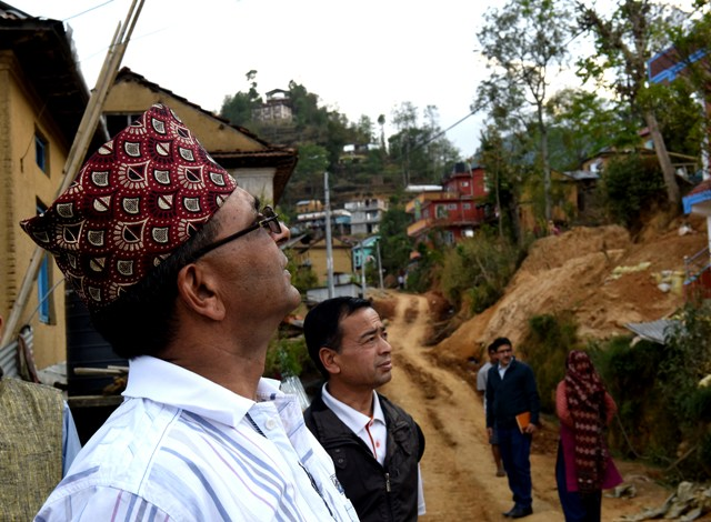 CEO Bhusal observing reconstruction at Balthali village, Kavre.